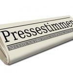 Zeitungsrolle mit Pressestimmen